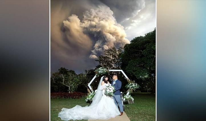 बैकग्राउंड में टाल ज्वालामुखी फटने के दौरान कपल ने रचाई शादी, तस्वीरें हुईं वायरल