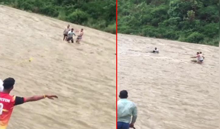 Una: बारिश से उफान पर आई खड्ड में स्कूटर सहित युवक बहा, किया Rescue