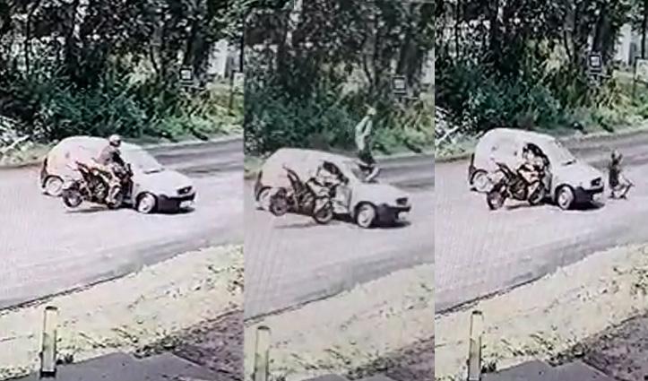 Car से टकराने के बाद फिल्मी स्टाइल में हवा में उछलकर खड़ा हो गया Bike सवार, वीडियो वायरल