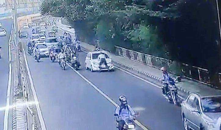 #Viral_Video : ट्रैफिक रूल का उल्लंघन करने पर रोका तो पुलिसकर्मी को Bonnet पर घसीटता ले गया कार चालक