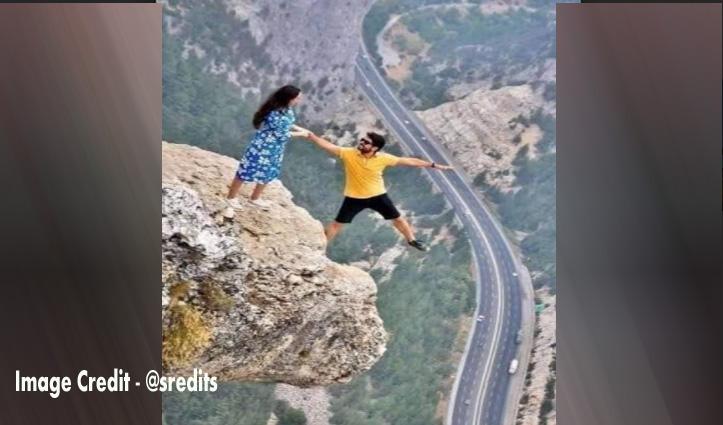 पहाड़ी पर लटका ये Couple, ऐसी खतरनाक फोटो देखकर किसी को भी लगेगा डर