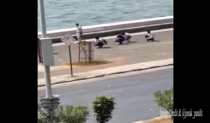 """बिना मास्क पहने समुद्र में घुसने की कोशिश कर रहे थे युवक, पुलिस ने करवाई """"मुर्गा वॉक"""""""